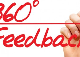 Hand writing 360 Degrees Feedback with red marker